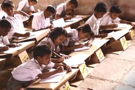 Desks made out of used cardboard boxes. Source: Dornob.com. Sponsored by Aarambh.com. 2014.