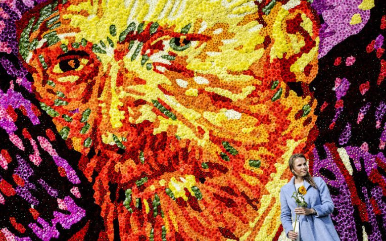 A tableau of flowers representing the face of famous Dutch painter Vincent van Gogh is revealed at Museumplein, Amsterdam, the Netherlands.